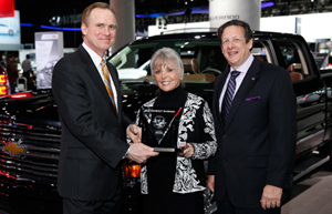 Lloyd Biermann, Silverado Marketing Manager accepts the 2014 Interntional Truck of the Year trophy for the Silverado. Presenting are Mike Martini, president Bridgestone OE America and ICOTY sponsor; and Courtney Caldwell, ICOTY founder and editor in chief Road & Travel Magazine