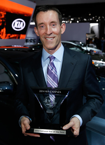 A happy Michael Sprague proudly displays Kia's 2nd year-running International Car of the Year Award