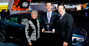 Michael Sprague, EVP marketing & communication Kia Motors America accepts trophy for 2014 International Car of the Year