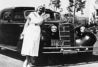 Jean Harlow by her Cadillac limousine.